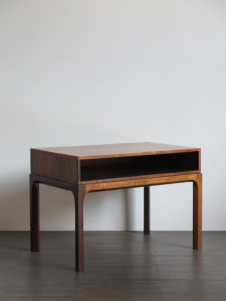 Scandinavian dark wood bedside table or side table design Aksel Kjersgaard for Odder Furniture, 1950s made in Denmark 1960s.   Please note that the item is original of the period and this shows normal signs of age and use.