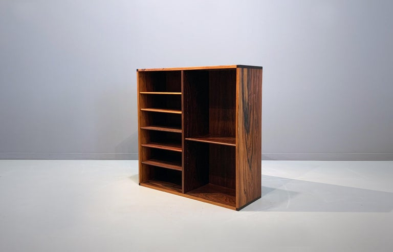 Aksel Kjersgaard wall-mounted cabinet produced in 1960s by. Beautiful structured rosewood veneer with solid rosewood edges. Danish modern midcentury. Perfect vintage condition.