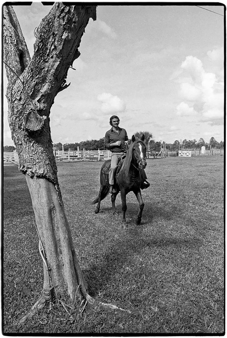 Al Satterwhite Black and White Photograph - Burt Reynolds, at his ranch, Jupiter, Florida, 1972