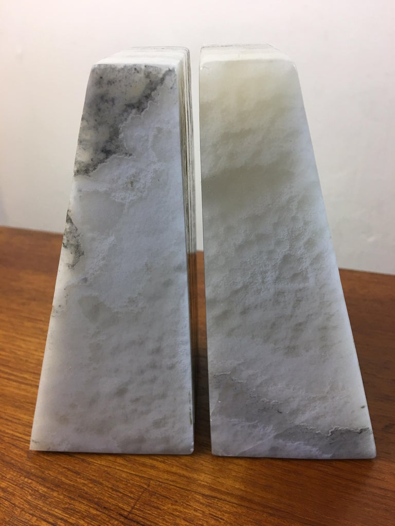 Alabaster bookends in an ivory stone. Wedge shaped!