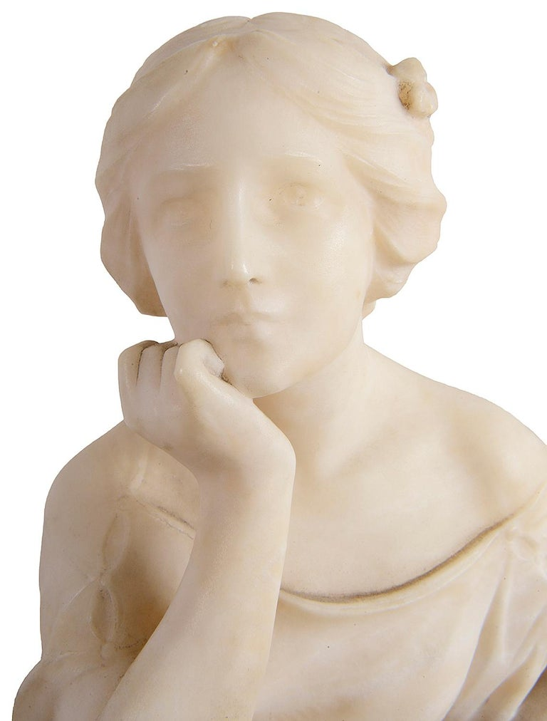 An enchanting 19th century carved alabaster statue of a young girl seated resting her chin. Size: 17.5