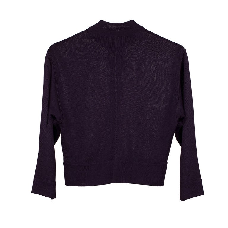 Azzedine Alaia aubergine colour cardigan with front button closure, dating to the early 1980's.  Material : Acetat 100%  Original Size : M (France) Shoulder - 41 cm, Under arm - 38 cm, Length - 43.5 cm Sleeve - 42.5 cm