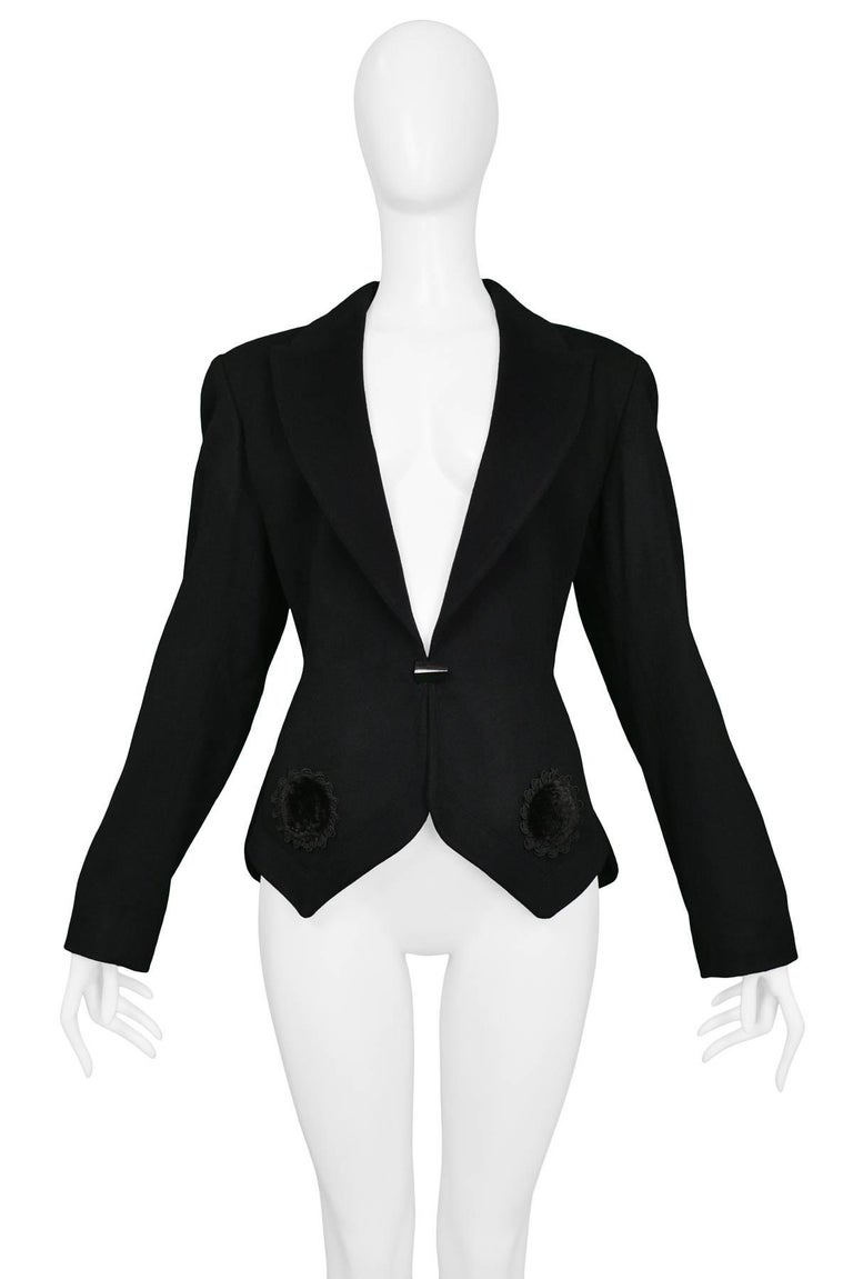 Vintage never worn black Azzedine Alaia wool fitted blazer featuring a velvet appliques at hem, classic lapel collar, straight sleeves, and jacket length, and button closure. Collection 1991.  Condition : Deadstock Vintage Size : 40