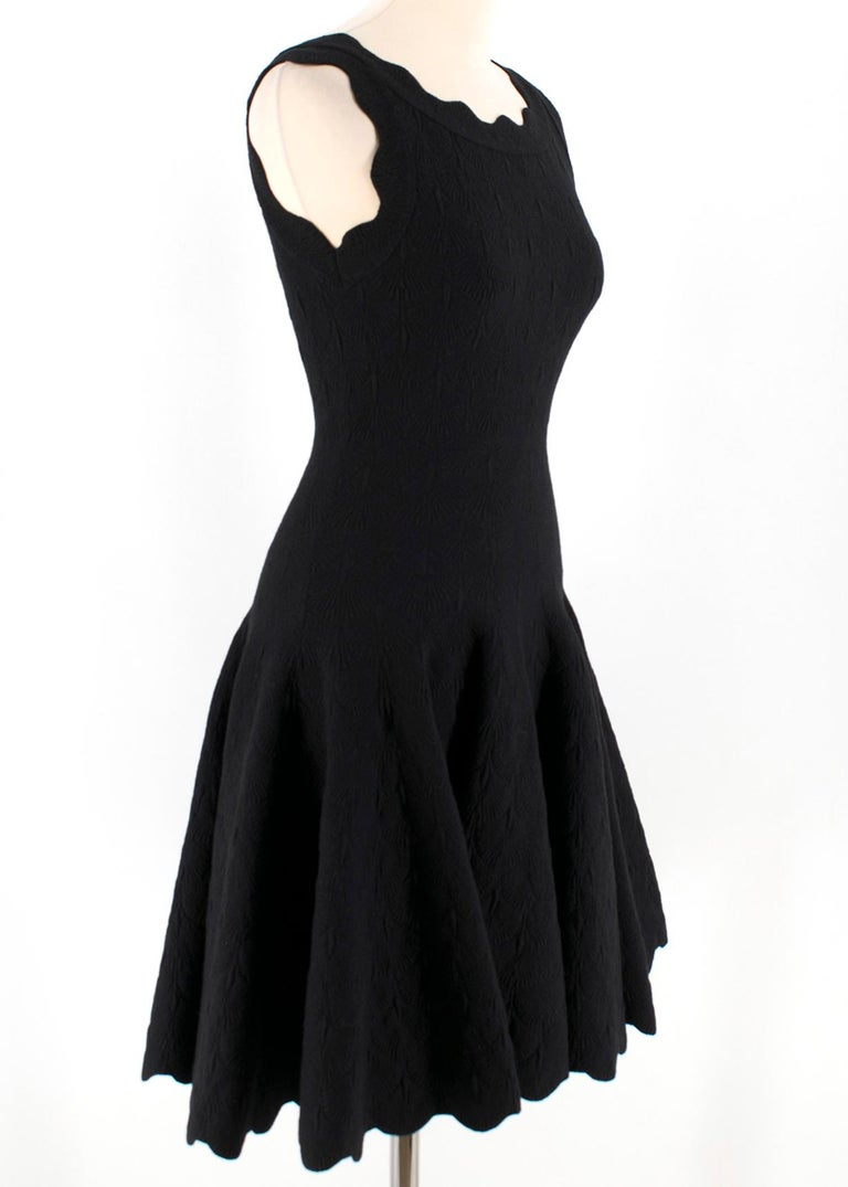 Alaia Black Jacquard-knit Scalloped Wool Mini Dress  - Jacquard Knit - Sleeveless - Black Skater style skirt with scalloped hem and bust - Made in Italy  Please note, these items are pre-owned and may show some signs of storage, even when unworn and
