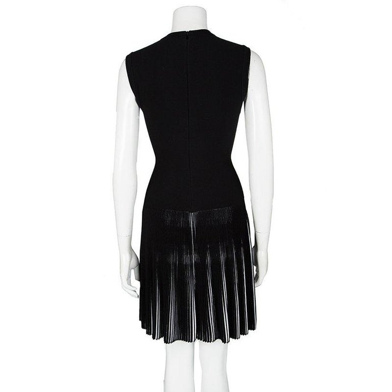 This dress from Alaia is so pretty, you'll love flaunting it. The fabulous black creation is made of the finest materials and features an elegant silhouette. It carries a V neckline and accordion pleats on the bottom half. Pair it with beige sandals