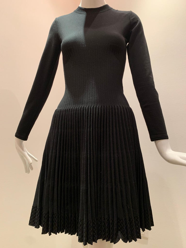 Alaia Black Knit Dress W/ High Neckline Dropped Waist and Pleated Flared Skirt For Sale 1