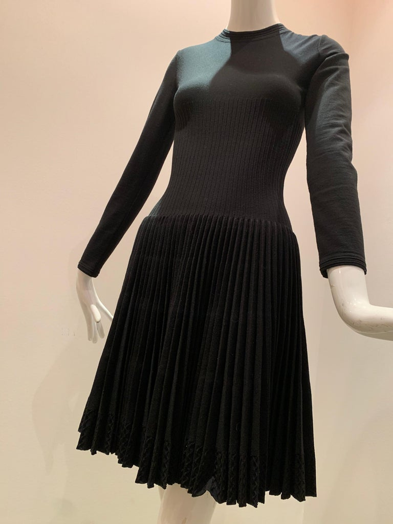Alaia Black Knit Dress W/ High Neckline Dropped Waist and Pleated Flared Skirt For Sale 2