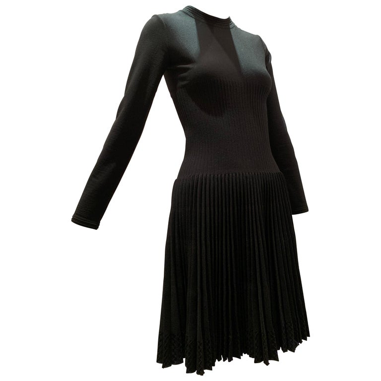Alaia Black Knit Dress W/ High Neckline Dropped Waist and Pleated Flared Skirt For Sale