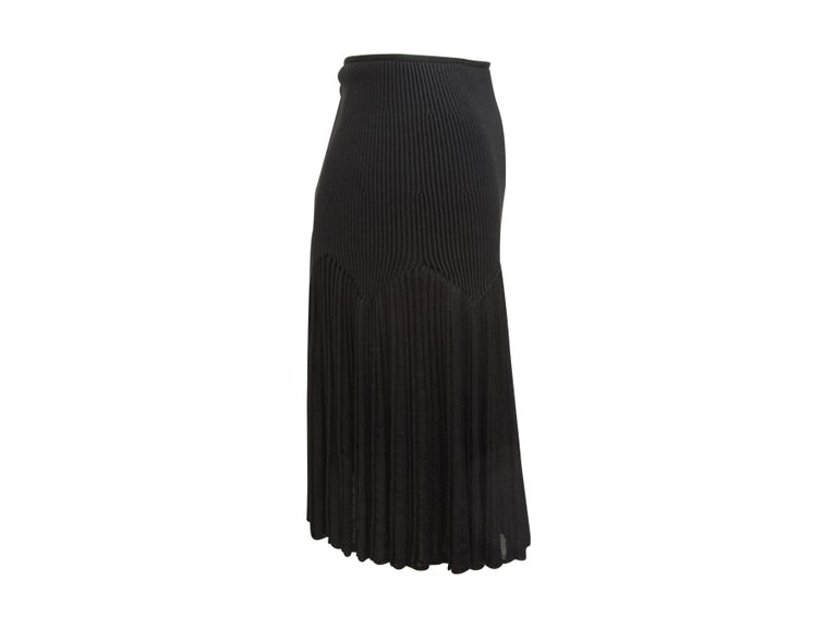 Product details:  Black ribbed knit skirt by Alaia.  Concealed back zip closure.  Pleated skirting.  Label size FR 36.  22