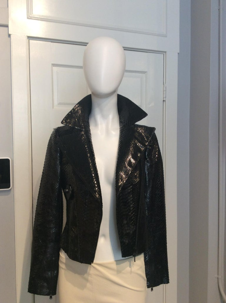 Alaia Black Snakeskin Cropped Moto Jacket, Size 38 Black Python Cropped Jacket with Triangular Cutout Details Asymmetrical Zipper Closure Zipper front pockets and Zippered sleeves