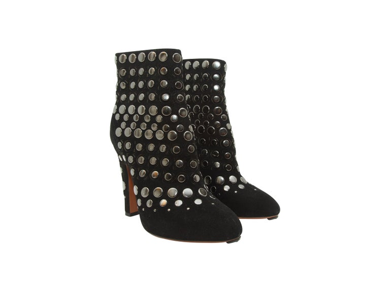 Product details:  Black studded suede ankle boots by Alaia.  Rounded almond toe.  Back zip closure.  Silvertone hardware.  4.5