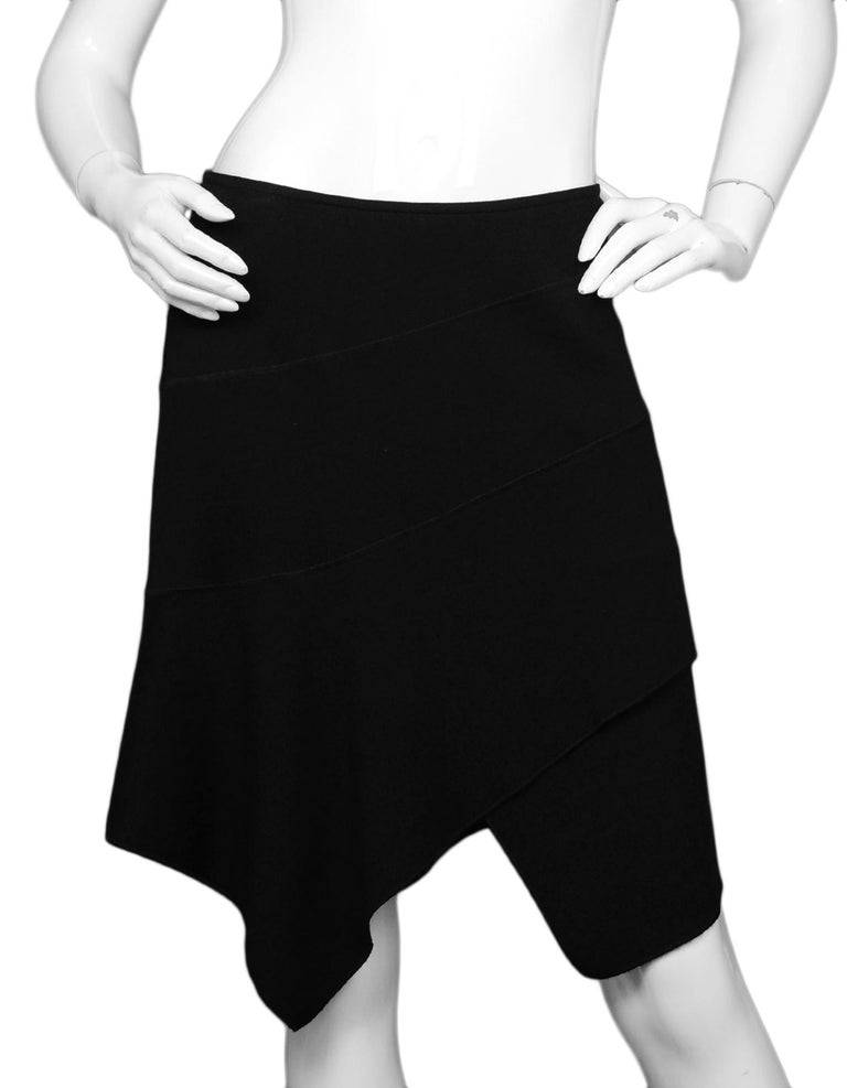 Alaia Black Wool Asymmetrical Skirt Sz Large  Made In:  Italy Color: Black Materials: 100% wool Closure/Opening: Hidden side zipper and hook eye Overall Condition: Excellent pre-owned condition   Measurements:  Waist: 28