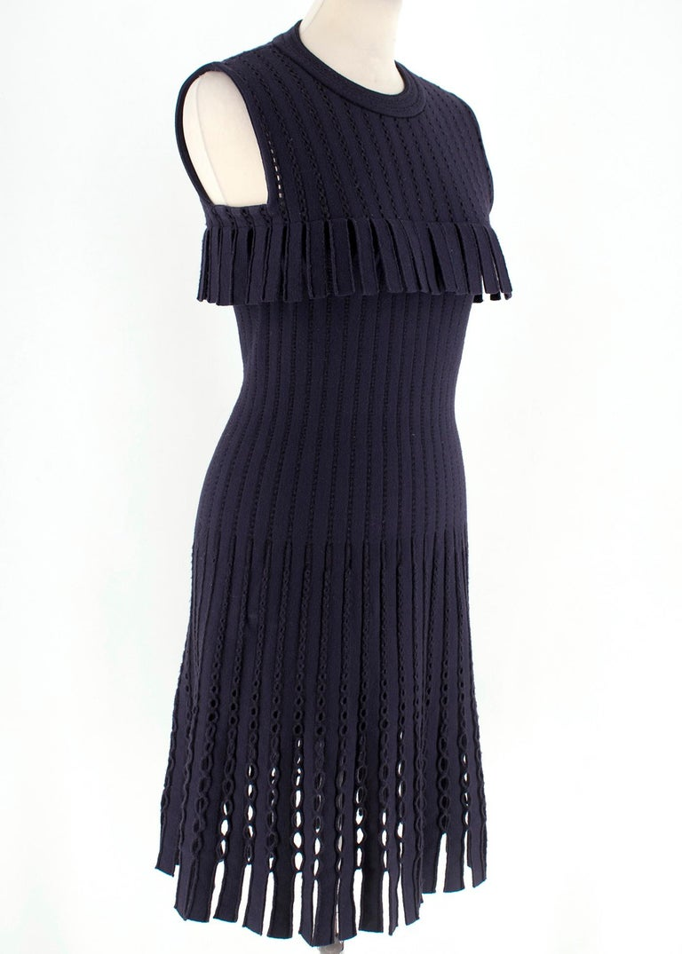 Alaia Navy/black striped wool dress. Featuring cut out and fringe details.  RRP £1775.00  - Mid-weigth knit  - Body con stretch fit - Loose at the hip - Concealed back zip closure - 70% Fleece Wool, 20% Polyamide, 10% Polyester - Made in Italy - Dry