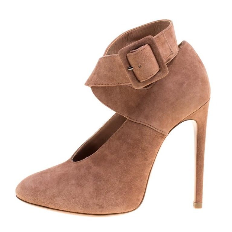 Team your chic outfits with this pair of dressy Alaia pumps. In a shade of brown, this pair features a gorgeous design of cross ankle straps and 11.5 cm heels. Be right on trend with these pumps made from suede.  Includes: The Luxury Closet