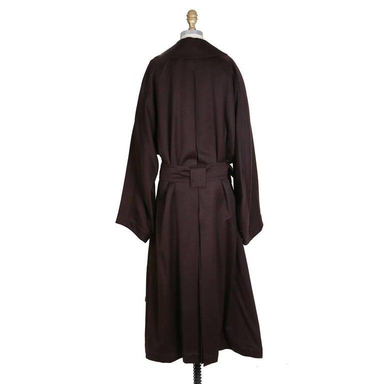 Long winter coat by Azzedine Alaia Double breasted and includes belt Dark plum color Condition: Excellent vintage condition  Size/Measurements: Size 6 46