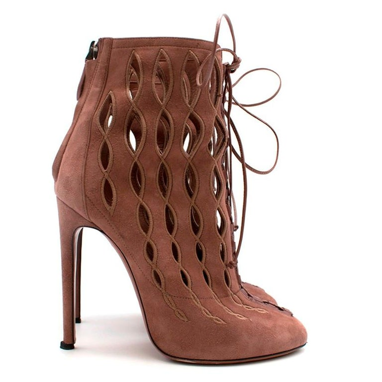 Alaia Goatskin Stiletto Lasercut Ankle Boots   RRP £925  Zips in back Perforated detail Laces in front Leather lining Rubber lining on sole Pointed rounded toe  Please note, these items are pre-owned and may show signs of being stored even when