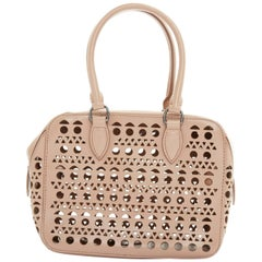 ALAIA nude leather geometric perforated cut out dual handle small shoulder bag
