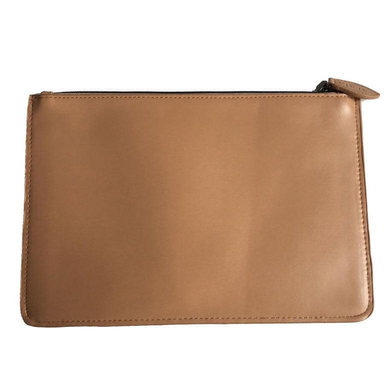 Alaïa pouch in pink beige leather. Inscription