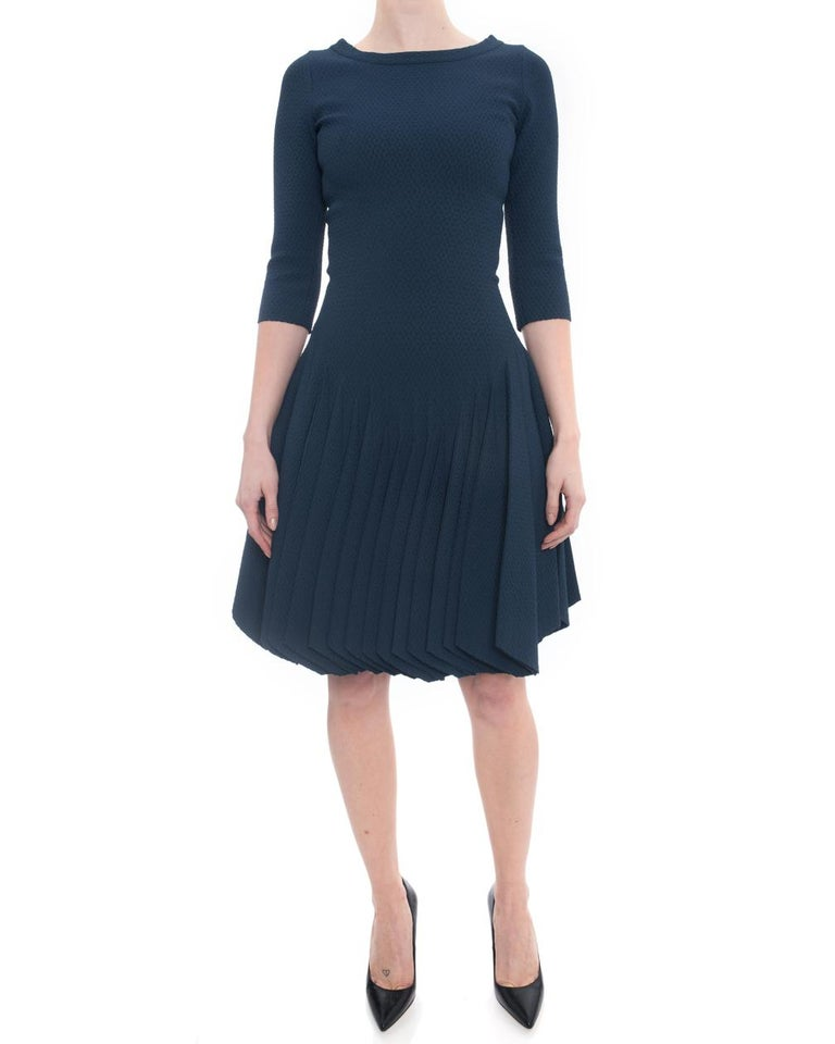 Alaia Prussian Blue Stretch Knit Fit and Flare Dress.  New with original price tag of $5795 from The Room.  Dark Prussian blue, boat neck design,  ¾ length sleeve, centre back zipper, flared skirt.  Marked size FR 38 (USA 6 but best for 4).  Please