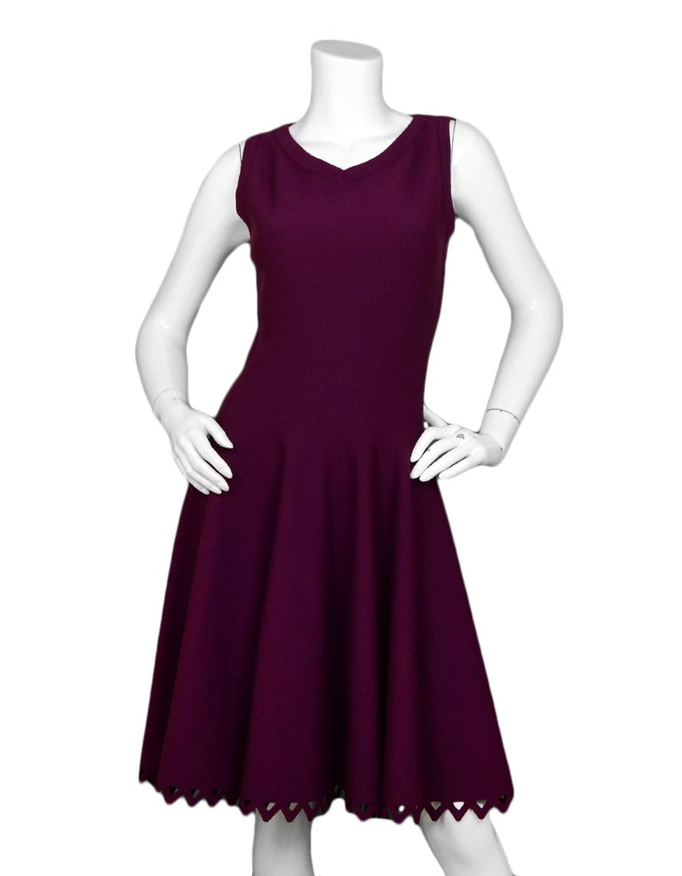 Alaia Raspberry Sleeveless Knit Flare Dress  Color: Raspberry Materials: Missing composition tag Opening/Closure: Hidden back zipper  Overall Condition: Very good pre-owned condition, with size and composition tags missing Tag Size: Size tag