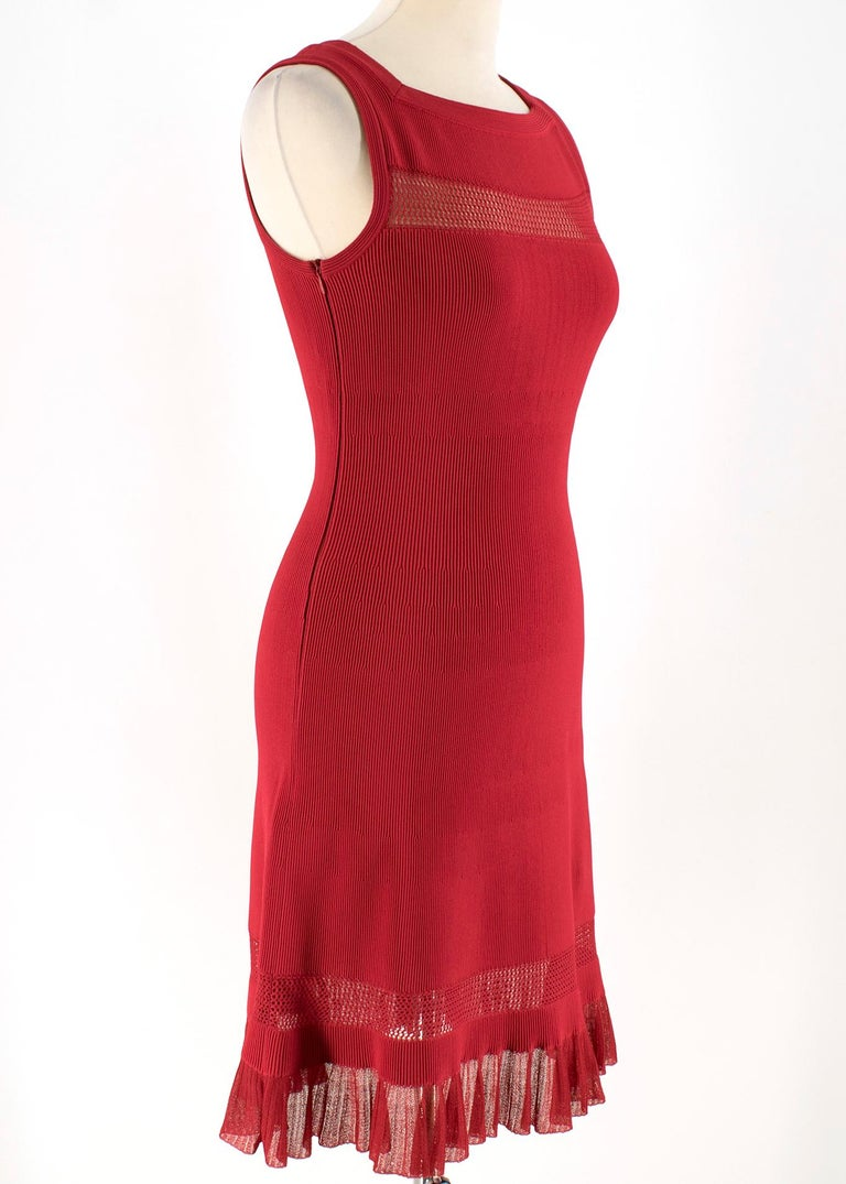 Alaia Red Fine Mesh Cut-Out Sleeveless Knit Dress  - Red, stretch fabric - Sleeveless - Fine Mesh cutouts to hem and bust  - Ruffle laced hem  - Fitted - Concealed zip fastening at the left side - Square neckline - 80% viscose, 16% polyester, 4%