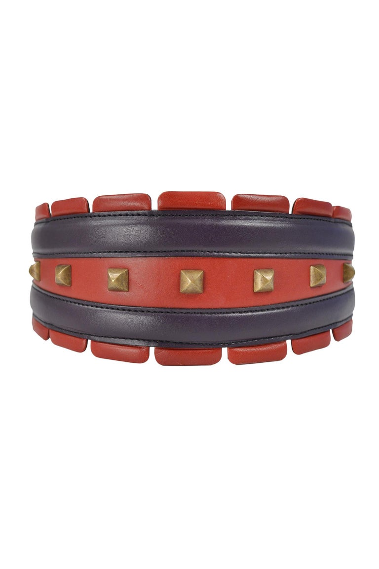 Vintage Azzedine Alaia red and purple leather tab waist belt with brass-toned square metal studs and double loop closure.   Excellent Vintage Condition.  Size 65