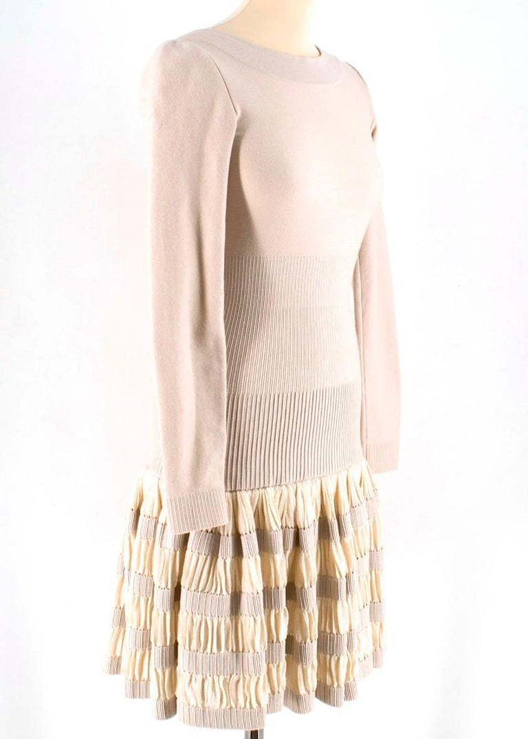 Alaia Beige Wool blend Knit Dress  - beige wool-blend dress - boat neckline - v back - unlined - zip fastening to the back - pleated base - above the knee length   Please note, these items are pre-owned and may show some signs of storage, even when