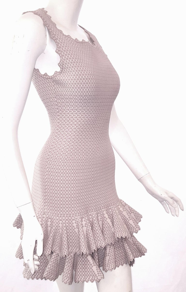 Alaïa is the choice of women for body-enhancing garments. Alaia is known for creating bodycon form fitting attire and is one of the most revered designers in fashion.  This sleeveless two tier ruffle dress is feminine and sexy at the same time.