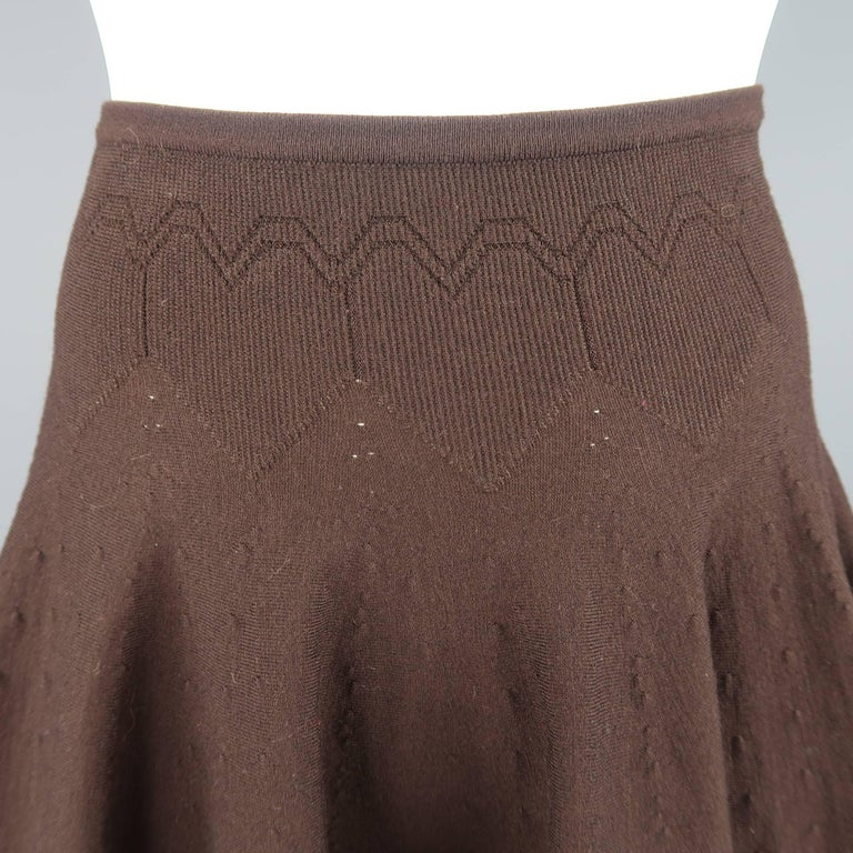 Archive ALAIA mini skirt comes in a chocolate brown wool blend knit with a high rise, heart pattern waistband, and A line ruffled flair silhouette. Made in Italy.   Good Pre-Owned Condition. Marked: XS   Measurements:   Waist: 24 in. Hip: 36