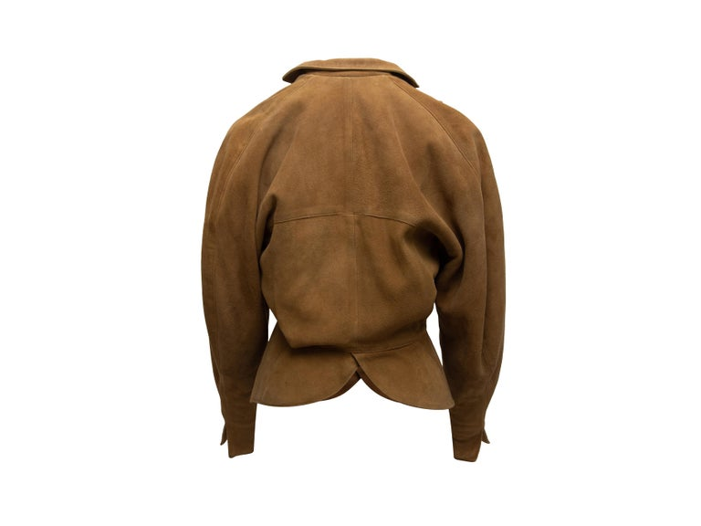 Product details: Vintage tan suede double-breasted jacket by Alaia. Oversize collar. Peplum hem. Button closures at front. Designer size 38. 40