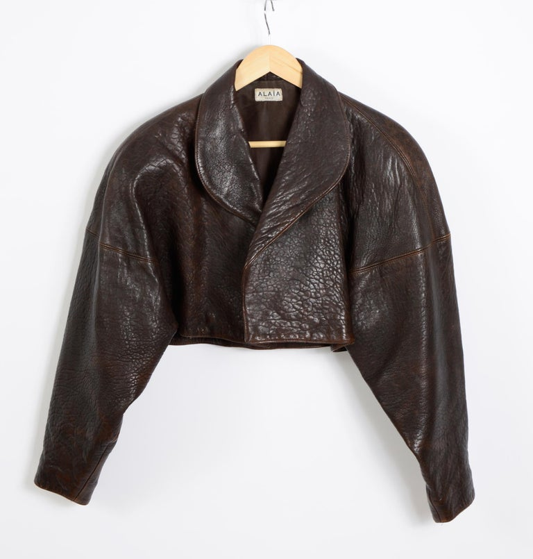 Beautiful 1980's brown leather cropped jacket by Azzedine Alaia. Size free.
