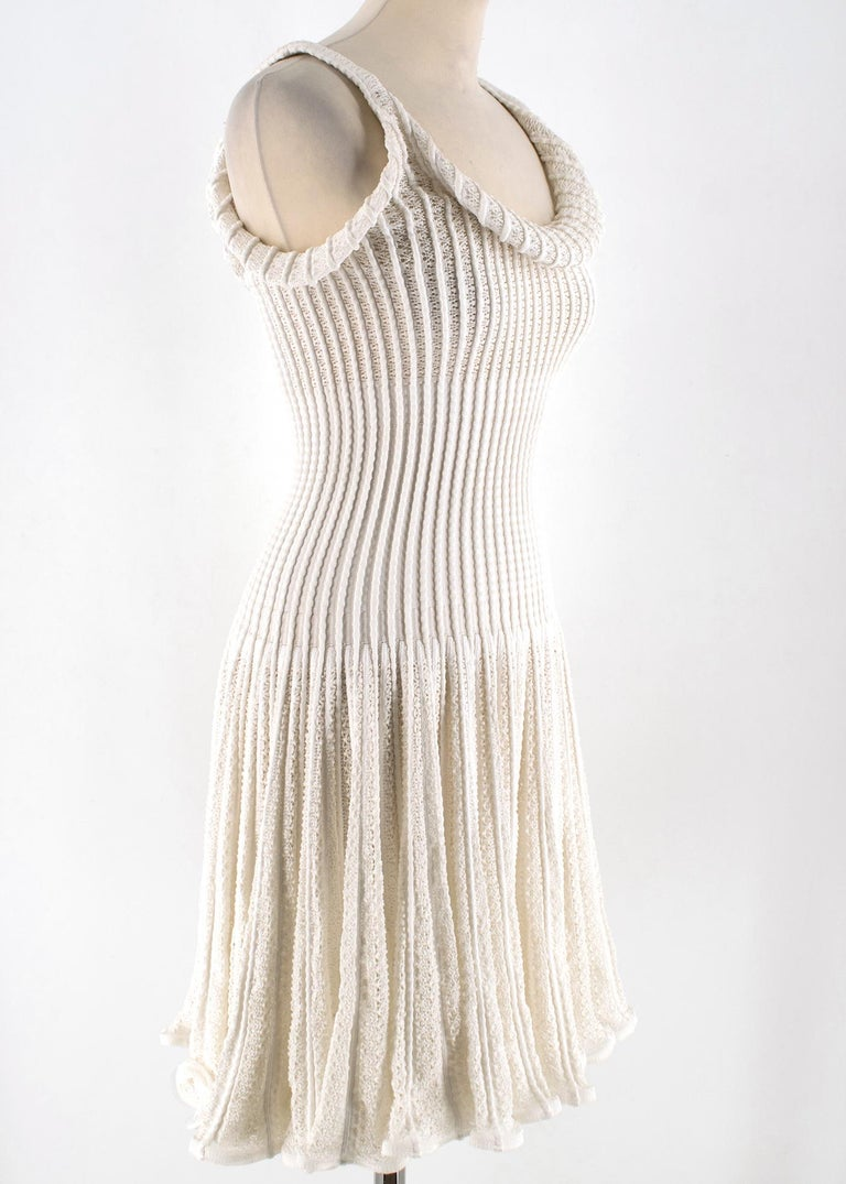 Stunning white ribbed knit dress in broderie anglaise. Bodycon upper fit with a flared skirt. RRP £2180.00  - Weighted knit - Invisible rear zip closure - Made in Italy - 50% Cotton, 25% Viscose, 25% Polyamide   Please note, these items are