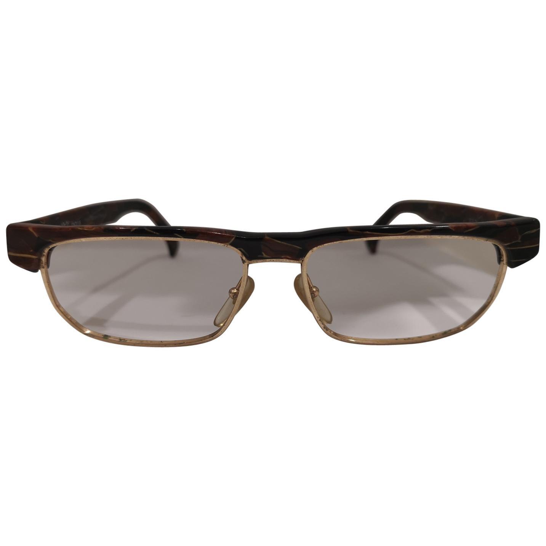 Alain Mikli tortoise gold frames