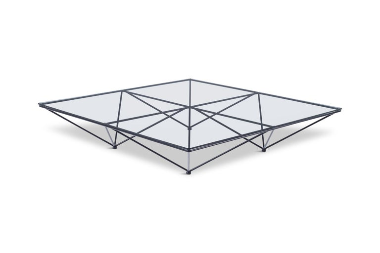 Paolo Piva original Alanda coffee table, an iconic piece that ushered in the 1980s, for B&B Italia .The Alanda's structure, serving as both pedestal and support, recalls a group of upturned pyramids, a geodetic frame that has always characterized it