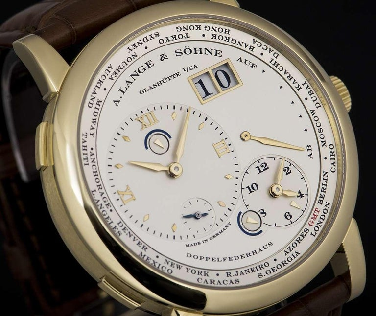 A. Lange & Söhne 18 karat Yellow Gold Silver Dial Time Zone 1 B&P 116.021 In Excellent Condition For Sale In London, GB