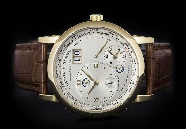 Men's A. Lange & Söhne 18 karat Yellow Gold Silver Dial Time Zone 1 B&P 116.021 For Sale
