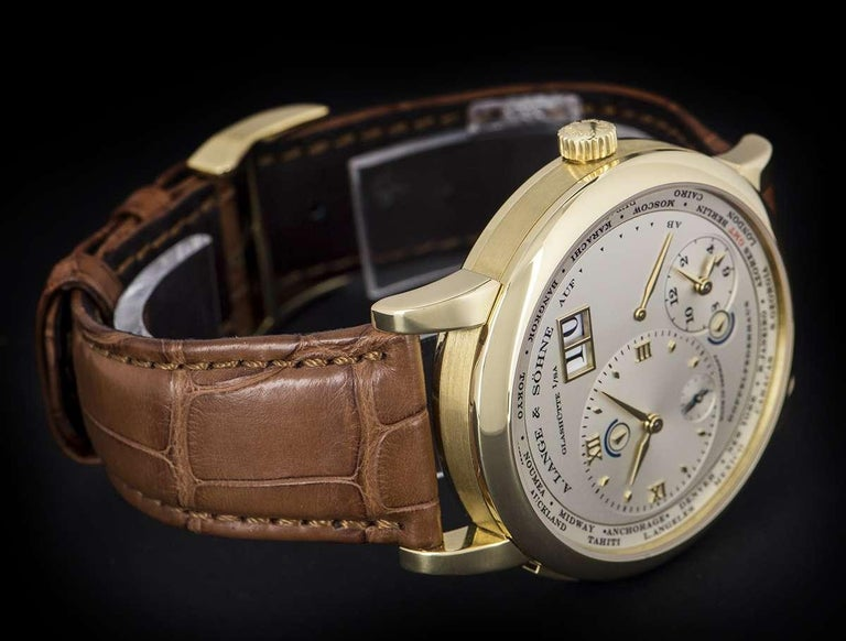A. Lange & Söhne 18 karat Yellow Gold Silver Dial Time Zone 1 B&P 116.021 For Sale 1