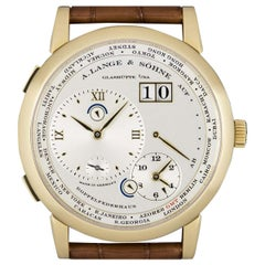 A. Lange & Söhne 18 karat Yellow Gold Silver Dial Time Zone 1 B&P 116.021