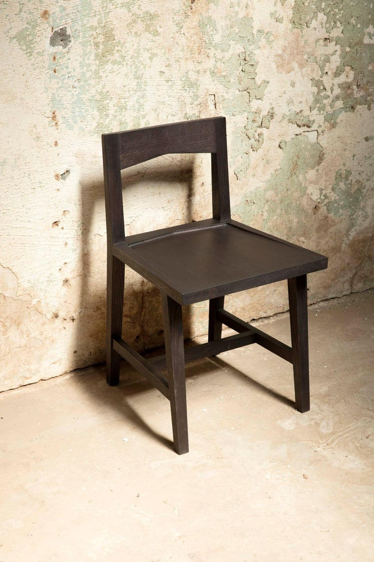 The Bowtie Chair by Alabama Sawyer is a Modern Solid Oak Chair with Black Oil Finish for Dining or Writing Height Seating. It combines elements of minimalist, modern design with rustic and rugged naturalism.  Made with wood from Birmingham's urban