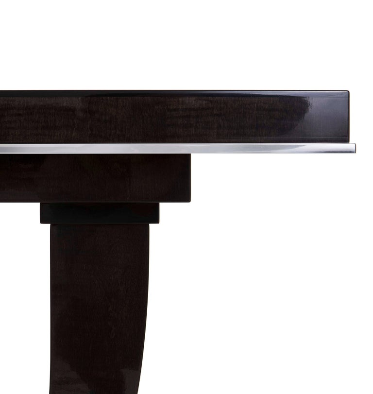 An Art Deco inspired console finished in sycamore black with polished nickel detail.