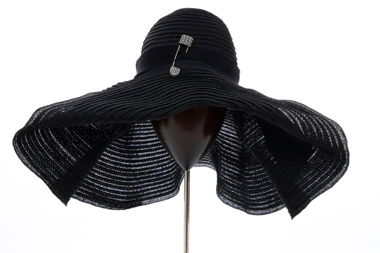 Alber Elbaz for Lanvin, Spring 2011, black woven straw sun hat with grosgrain trim and jeweled pin accent.     Designer size 56.  Circumference: 23
