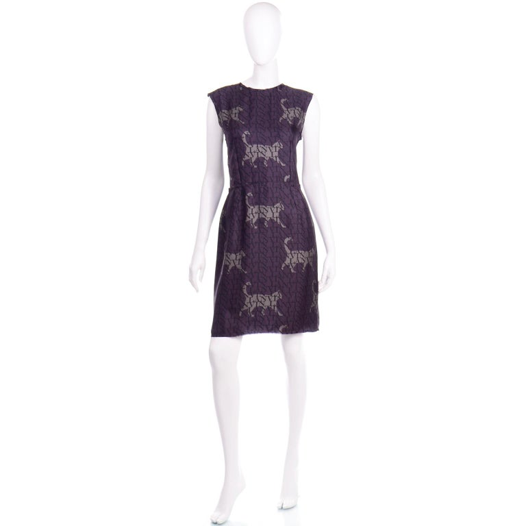 This is such a beautiful Lanvin silk dress with a monogrammed logo print and cat figure outlines. This dress would be easy to dress up for a special evening out or wear it with casual shoes for a lunch date! The base color is purple and the print is