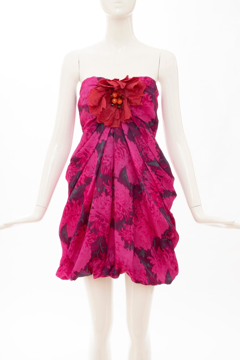 Lanvin, Spring 2010 magenta silk printed floral strapless evening dress with embroidered linen & faceted glass flower at bust with exposed zip and hook-and-eye closure at center back, fully lined in silk.  FR. 36, US. 4  Bust: 25, Waist: 25, Hip: