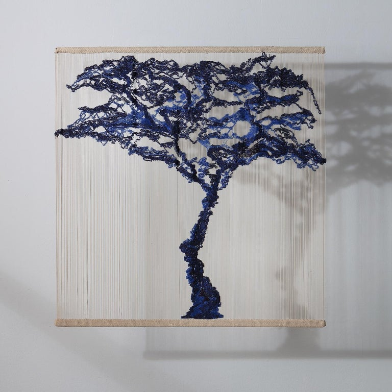 A stunning vertical handwoven tapestry of Japanese inspiration, the Tree is composed of wool, cotton, silk and linen threads in blue using traditional techniques. In a decorative play of shadows, the piece is viewed at its best when hung at a