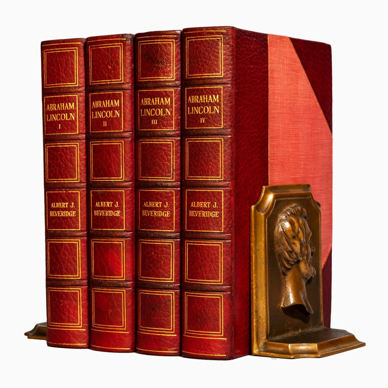 """4 volumes.  Abraham Lincoln (1809-1858) with illustrations. """"Manuscript Edition"""". Volumes one with a manuscript by Beveridge. Bound in 3/4 red Morocco, cloth boards, top edges gilt, raised bands, gilt panels.   Published: Boston & New York:"""