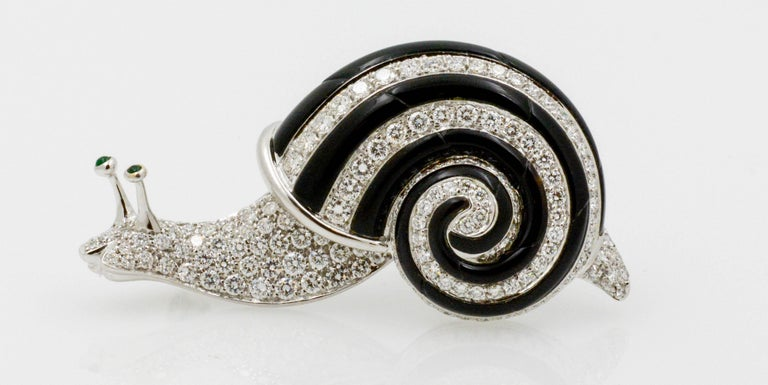 Circa 1980's brooch designed by Albert Lipten.  18 karat white gold snail set with 3.0 carats total weight round brilliant cut diamonds (G color, VS internal clarity).