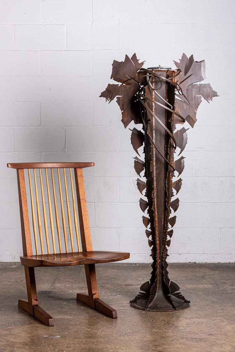 A large scale, forged steel floor vase with removable insert. Signed and dated Albert Paley, 1993-1994.