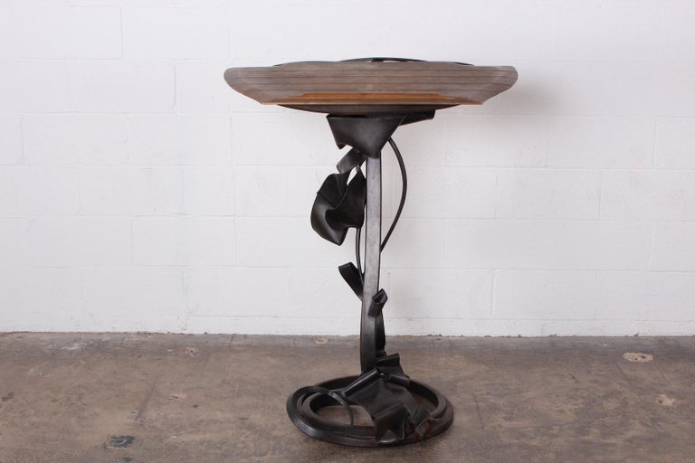 A bronze and forged steel lectern by Albert Paley signed and dated 1990.