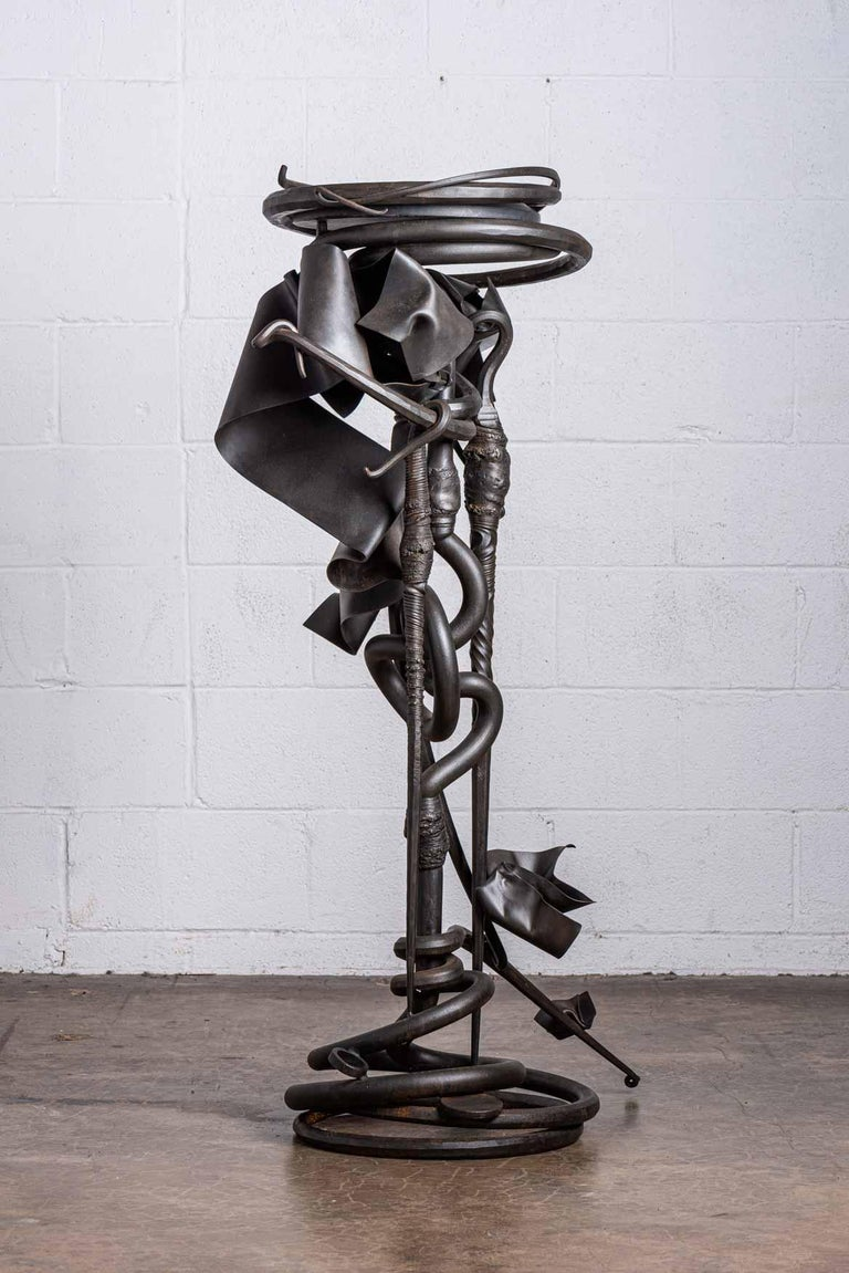 A forged steel plant stand with slate top. Signed and dated Albert Paley, 1993.