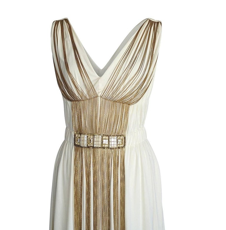 Guaranteed authentic Alberta Ferretti cream dress with delicate chains creating shape and accentuating the front.  Stones at waist are set with fine 'rope' and edged in matte sequins. V shaped front and rear with soft pleated detail.  Unique empire
